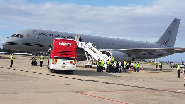 Harry and Meghan will fly out on this plane. The bus carrying New Zealand's Invictus athletes is parked on the tarmac at Sydney Airport. Picture: Candace Sutton