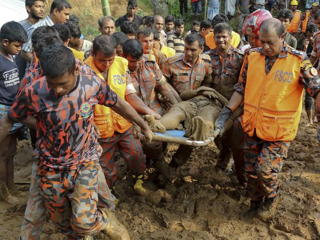 Rescuers carry the dead body of a victim after Tuesday's massive landslide in Rangamati district, Bangladesh. Picture: AP Photo