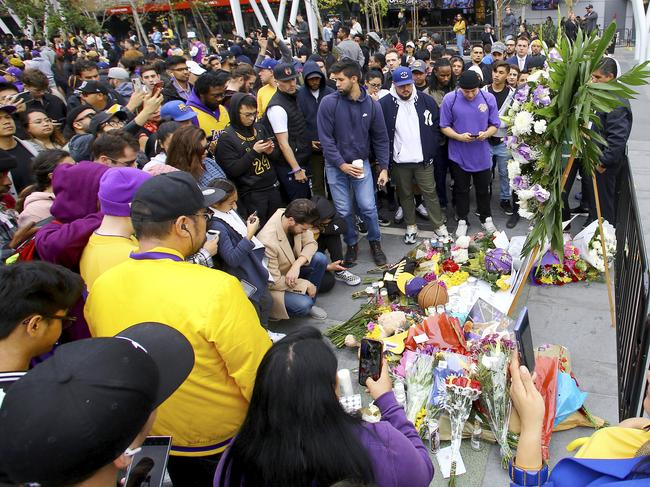 Fans congregated outside the Staples Center to pay tribute to Bryant.