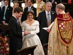 Dean of Windsor, David Conner (R) presides over the wedding ceremony of Britain's Princess Eugenie of York (C) and Jack Brooksbank (L) at St George's Chapel, Windsor Castle, in Windsor, on October 12, 2018. (Photo by Jonathan Brady / POOL / AFP)