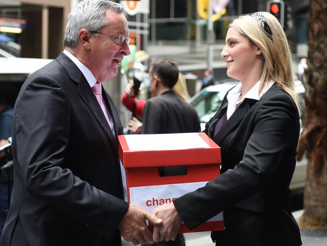 Sydney gang-rape victim Katrina Keshishian (right) delivers her 120,000-strong petition to NSW Attorney-General Brad Hazzard in Sydney yesterday. Picture: AAP/Dean Lewins