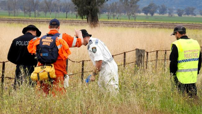 Police and SES conduct a line search near the Gunnedah farmhouse where a 14-year-old girl allegedly murdered her 10-year-old cousin. Picture: Nathan Edwards