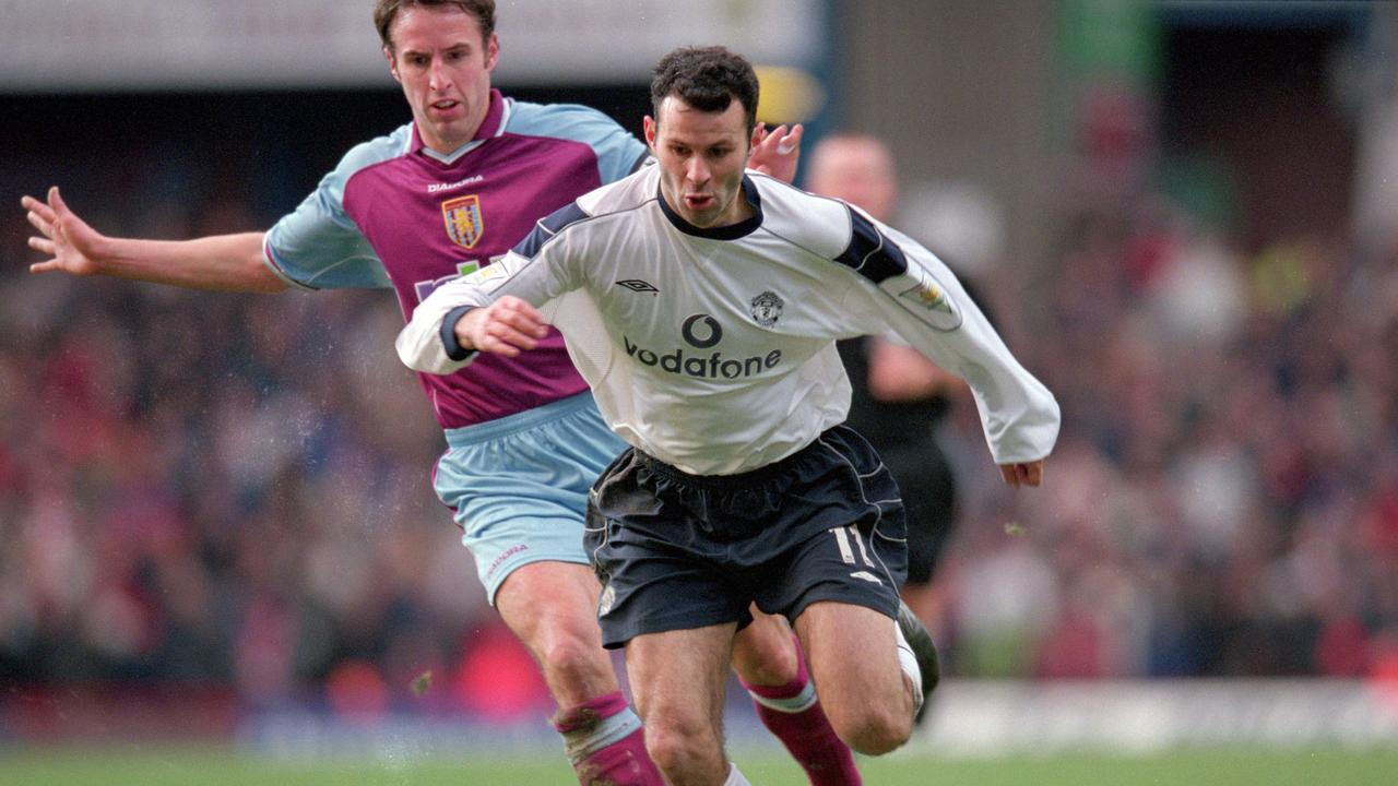 Aston Villa's Gareth Southgate (L) chases down Manchester United's Ryan Giggs.