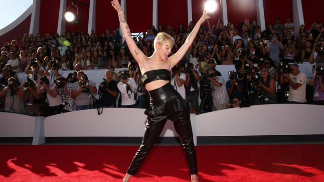 Miley Cyrus being her usual shy self on the VMAs red carpet.