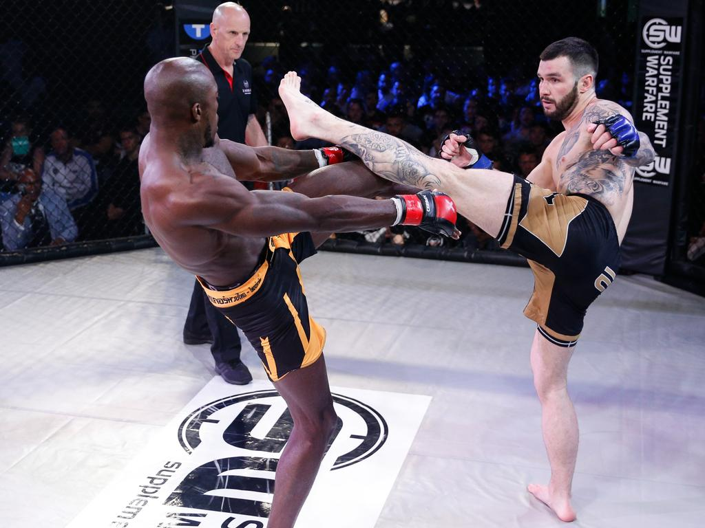 MMA fighter Shane Mitchell and his opponent Jason Radcliffe clash legs during their fight at Adelaide Oval last year (2017) for Diamondback Fighting Championship 4. Picture: Justin White.