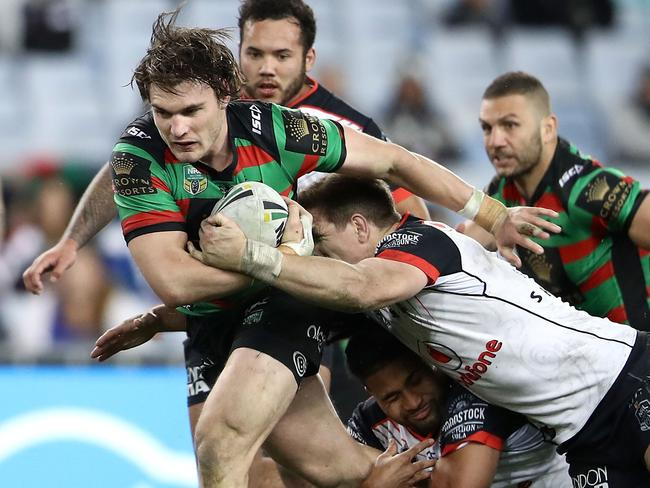 Angus Crichton of the Rabbitohs is tackled.