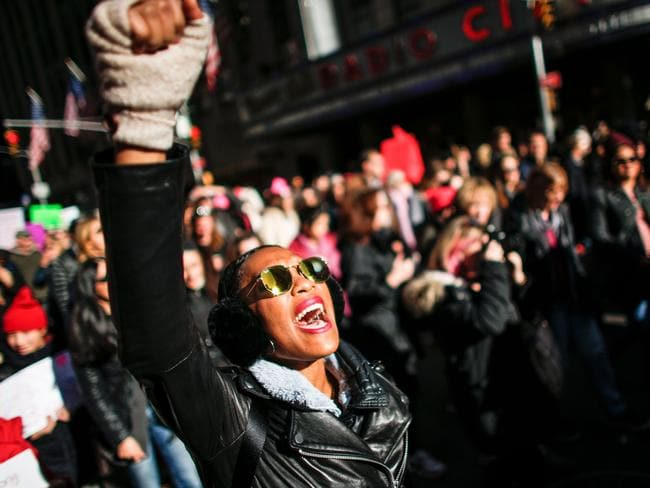 A woman shouts slogans during the Women's March in New York City in January. The first one the day after Mr Trump's inauguration was the largest single-day protest in US history. Picture: AFP/Kena Betancur