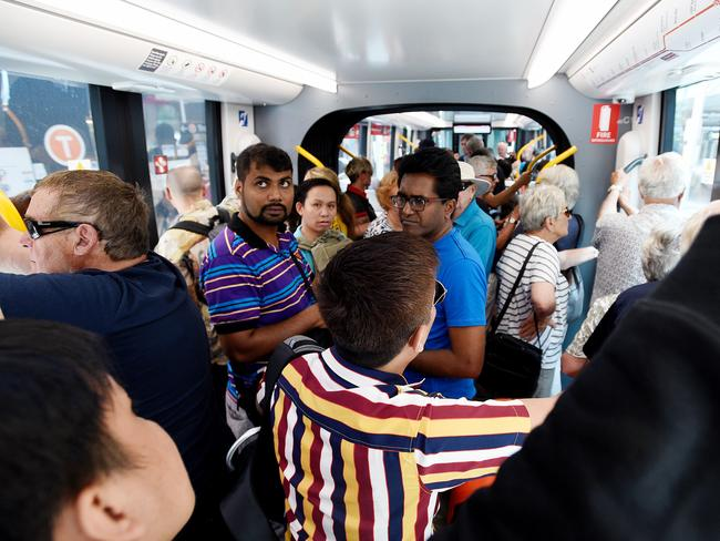 Passengers are seen on-board the new light rail after it was officially opened to the public at Circular Quay in Sydney, Saturday, December 14, 2019. (AAP Image/Bianca De Marchi) NO ARCHIVING