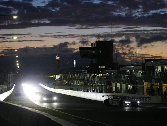 Headlights on with the race starting before dawn.