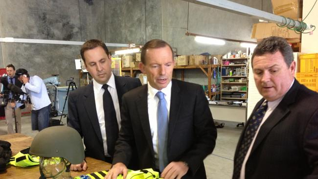 Blue tie? What blue tie? Tony Abbott today on the Gold Coast.