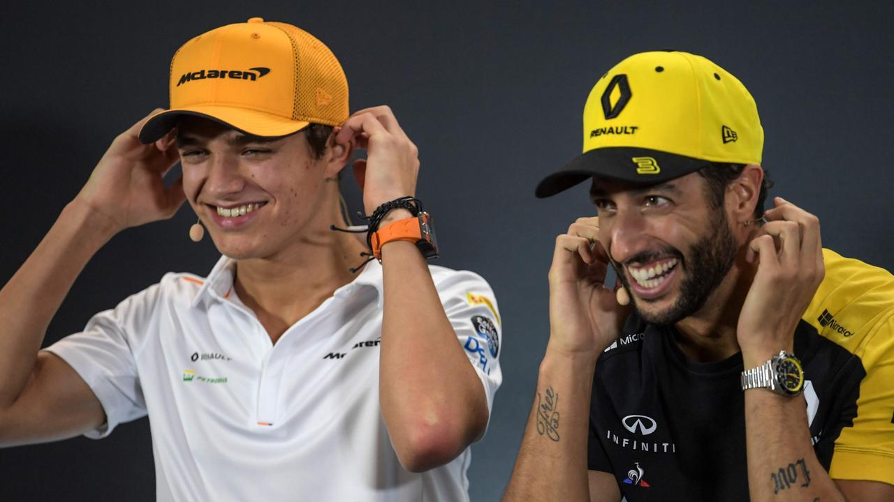 Lando Norris and Daniel Ricciardo will be teammates this season. (Photo by Roslan RAHMAN / AFP)