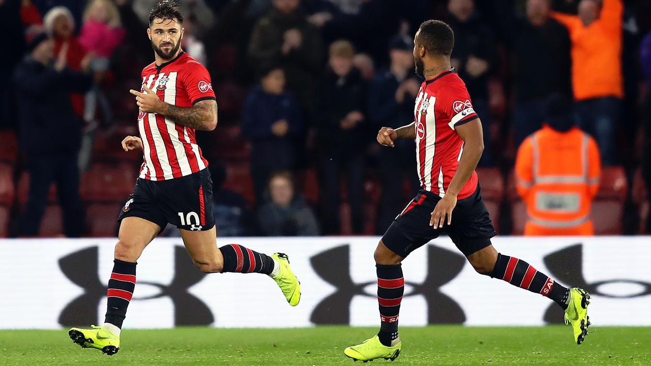 Charlie Austin of Southampton runs to the bench to celebrate a goal which was then disallowed