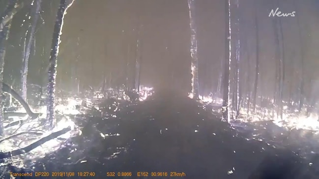 Incredible footage of firefighters driving through blaze in NSW