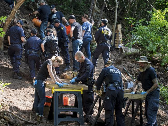 Members of the Toronto Police Service excavate the back of a property in Toronto during an investigation in relation to serial killer Bruce McArthur. Picture: AP