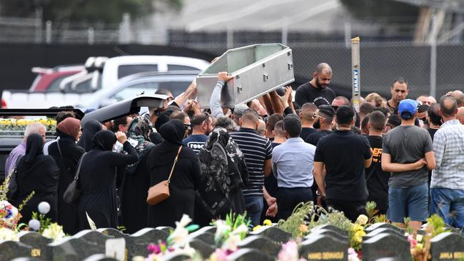Mourners Lift An Empty Coffin Above Their Heads During The Burial Of Mahmoud Mick Hawi At Rookwood Cemetery Picture Aap