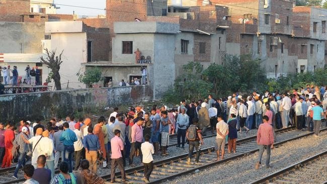 Indian people gather at the scene of an accident along railroad tracks in Amritsar. Picture: AFP