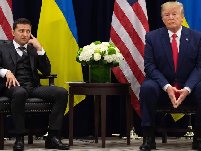 """US President Donald Trump and Ukrainian President Volodymyr Zelensky had a phone call which is now the centre of an impeachment inquiry that Mr Trump has called a """"scam"""". Picture: AFP"""