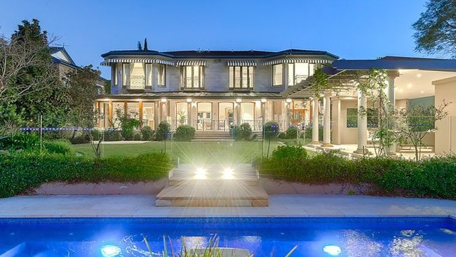 This riverfront mansion at 95-99 McConnell St, Bulimba, has sold at auction.
