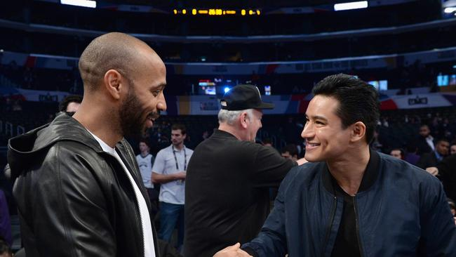 Thierry Henry and Mario Lopez attend the NBA All-Star Game 2018