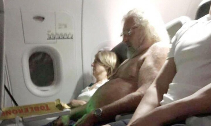 Topless man raises eyebrows on flight and passengers question if it's Santa
