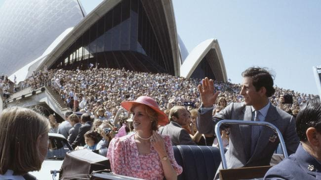 Prince Charles and Princess Diana ride in an open top car as they tour Sydney in 1983. Picture: Bob Thomas/Popperfoto