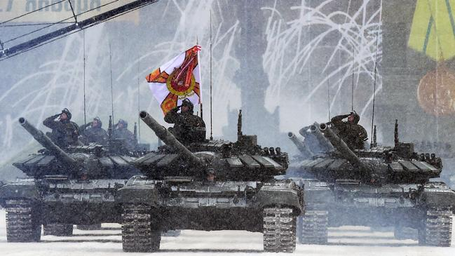 Russian T-72B3 tanks drive during the military parade marking the 75th anniversary of the lifting of the Nazi siege of Leningrad. Picture: Olga Maltseva