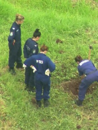 Police officers dig on a twelve tribes property near the NSW town of Picton. Picture: ABC