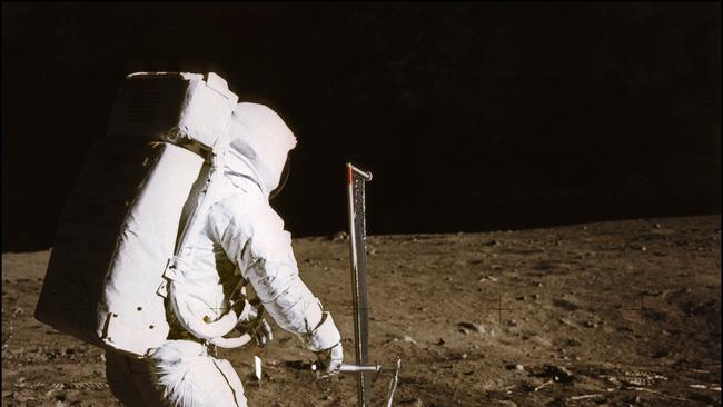 In this 1969 photo taken by astronaut Neil A. Armstrong, you can see Buzz Aldrin conducting experiments on the moon's surface, during the Apollo 11 space mission. Picture: AFP/NASA