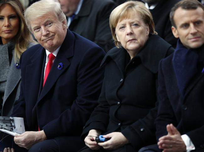 U.S. President Donald Trump, German Chancellor Angela Merkel and French President Emmanuel Macron in Paris. Picture: AP Photo/Francois Mori, Pool, File.