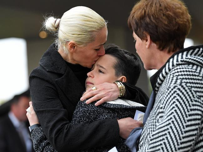 Ms Lekaj's brother Pyrrhus being comforted by mother Romina and grandmother at her funeral. Picture: Tom Huntley