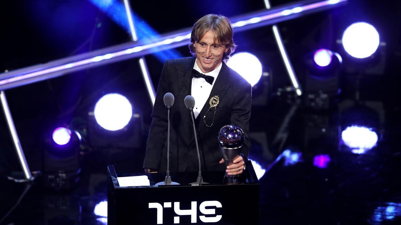 Luka Modric of Real Madrid receives the trophy for The Best FIFA Men's Player 2018