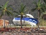 A boat is seen smashed against the bank at Shute Harbour, Airlie Beach, Wednesday, March 29, 2017. Cyclone Debbie has hit Queensland's far north coast yesterday as a category 4 cyclone, causing wide spread damage. Picture: AAP Image/Dan Peled