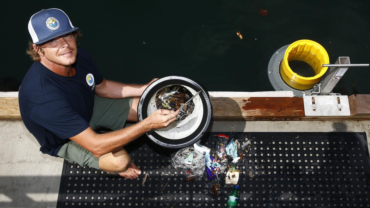 Pete Ceglinksi holding the filter bag from one of his seabins and some of the rubbish it has collected. Picture: John Appleyard