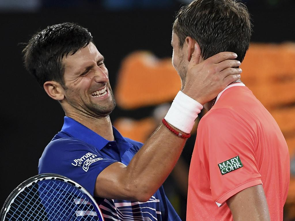 Serbia's Novak Djokovic is congratulated by Russia's Daniil Medvedev, right, after winning their fourth round match at the Australian Open tennis championships in Melbourne, Australia, Tuesday, Jan. 22, 2019. (AP Photo/Andy Brownbill)