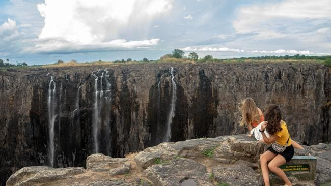 No smoke, no thunder ... tourists enjoy a serene time as they look on trickles of water at the Victoria Falls, on December 10, 2019. Photo: Zinyange Auntony/AFP