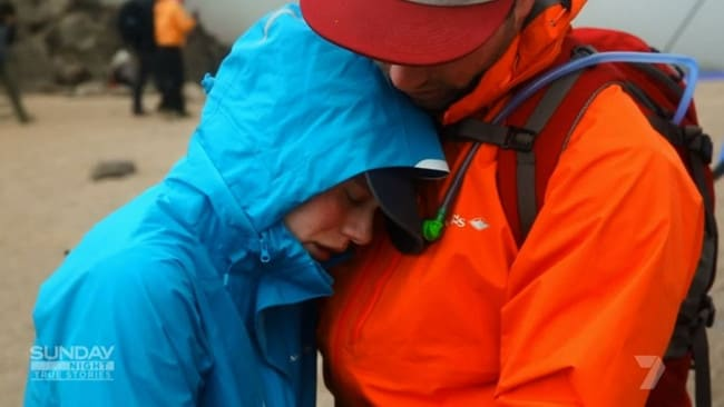 Meg Draffin is comforted by her boyfriend Nathan Roye during the climb. Picture: Sunday Night