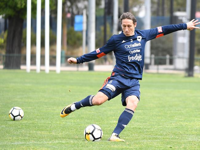 Mark Milligan of Melbourne Victory trains at Gosch's Paddock in Melbourne