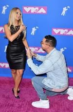 US TV personalities Lauren Pesce and Mike Sorrentino attend the 2018 MTV Video Music Awards at Radio City Music Hall on August 20, 2018 in New York City. Picture: ANGELA WEISS / AFP