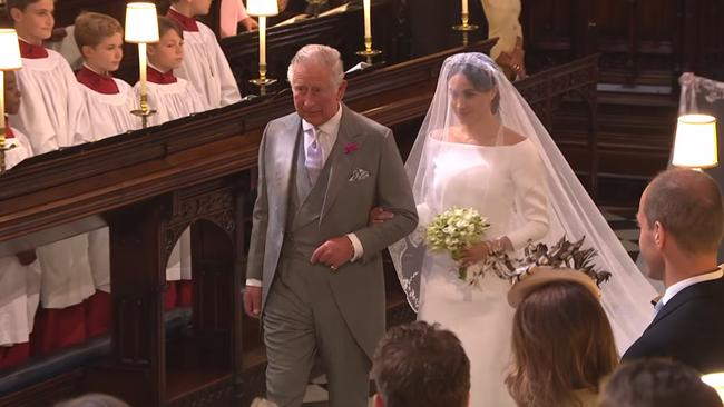 The touching moment Charles walked Meghan down the aisle. Picture: BBC