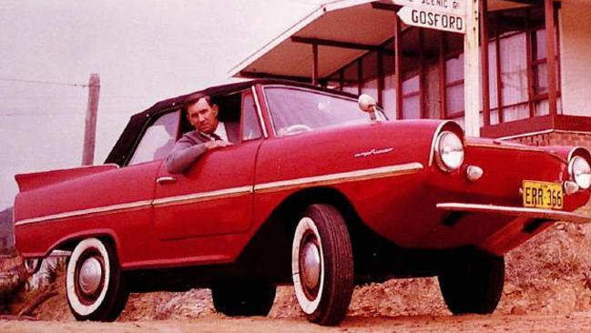 Rod Radford in his Amphicar amphibious car in the 1960s. He used to commute across the entrance to Brisbane Water from his home in Wagstaff to his business in Ettalong, NSW.