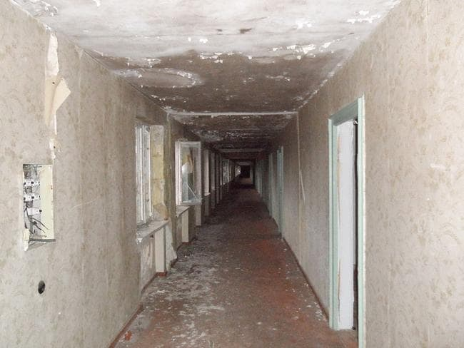Inside a derelict hall in one of the buildings.