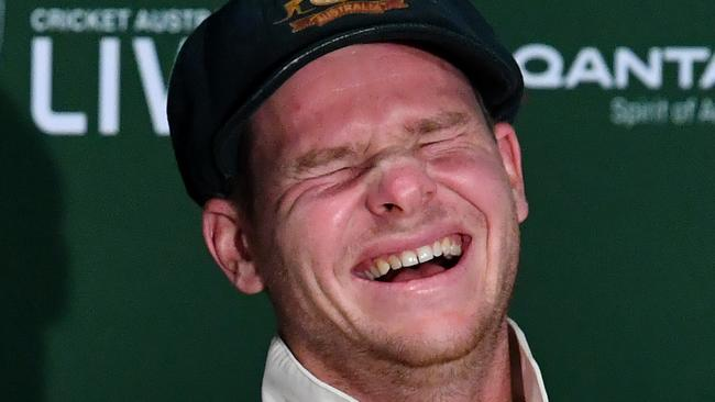 Australian captain Steve Smith is seen reacting to questions from the media about England wicketkeeper Jonny Bairstow.
