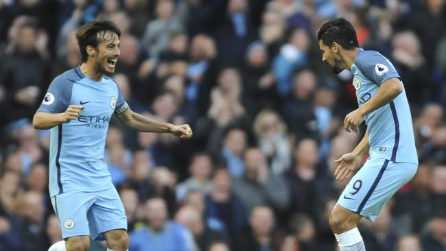 Manchester City's Nolito, right, celebrates with David Silva after scoring.