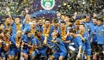 "(FILES) This file photo taken on November 12, 2020 shows Jiangsu Suning players and staff members celebrating after their team defeated Guangzhou Evergrande to win the Chinese Super League (CSL) football championship in Suzhou in China's eastern Jiangsu province. - Chinese Super League champions Jiangsu FC have ""ceased operations"", the club said on February 28, 2021, underlining the financial problems coursing through football in the country. (Photo by STR / AFP) / - China OUT"