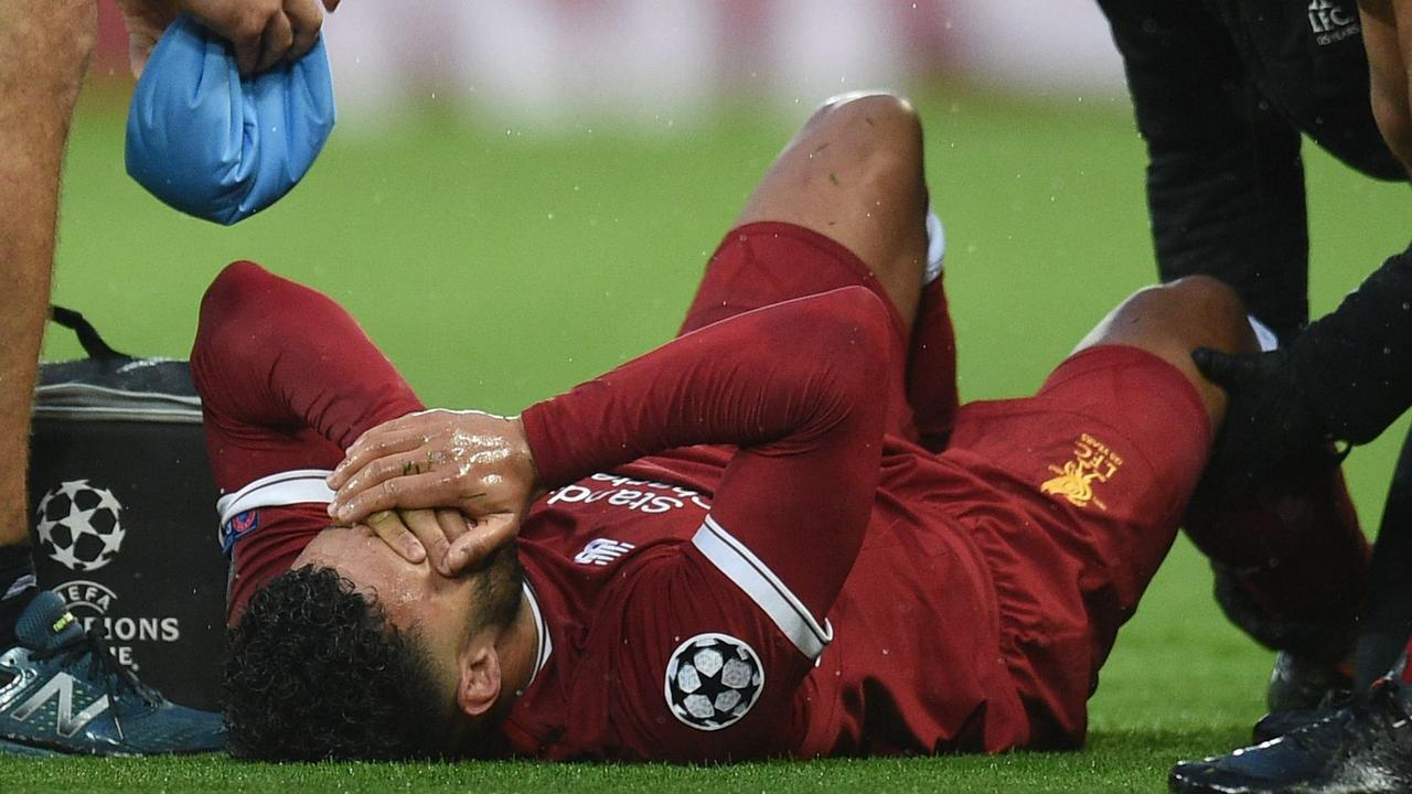 Liverpool's Alex Oxlade-Chamberlain reacts after picking up an injury during the UEFA Champions League semi-final.