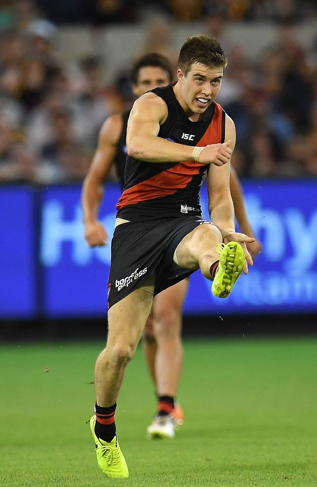 Zach Merrett of the Bombers in action against the Hawks.