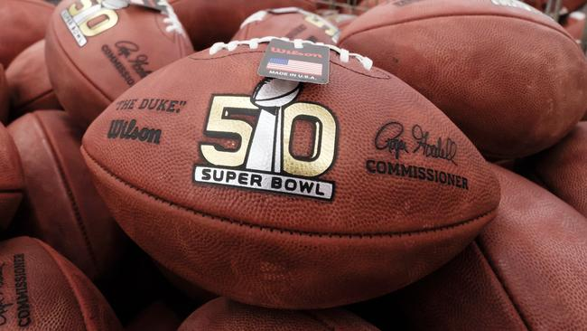 Official balls for the NFL Super Bowl 50 football game are seen in a bin prior