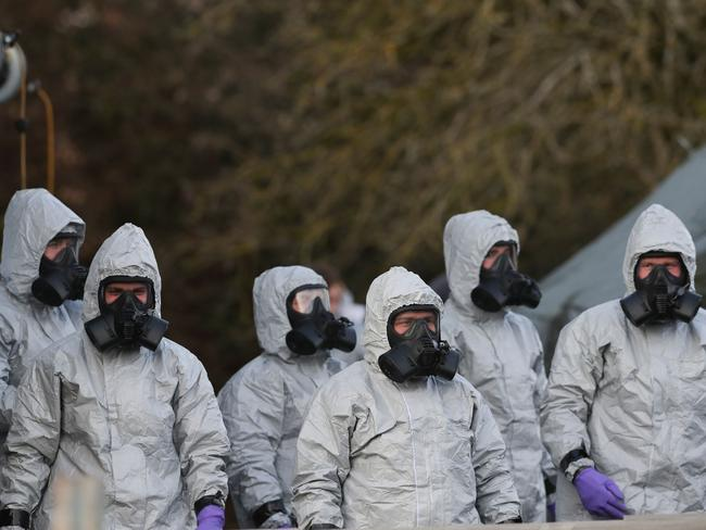 Personnel in protective coveralls and breathing equipment work at the Salisbury District Hospital where Sergei Skirpal and his daughter were poisoned. Picture: AFP