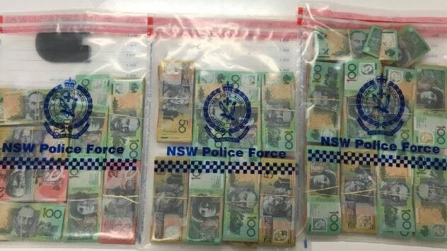 Police searched the man's suitcase and allegedly found a substance believed to be cocaine along with the whopping amount of cash.