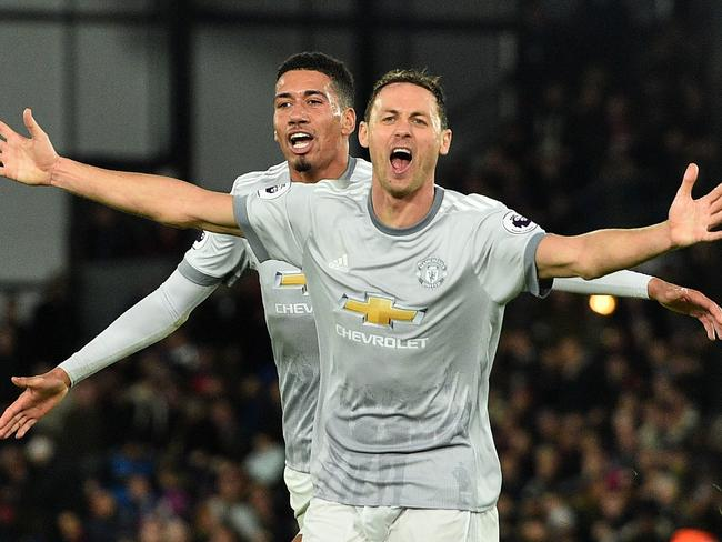 Nemanja Matic (R) celebrates his winner.